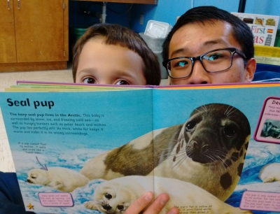 Reading about seal pups with my SEAL pup